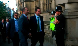 Nick Clegg is received by Paul Scriven and angry protestors as he arrives at the Town Hall